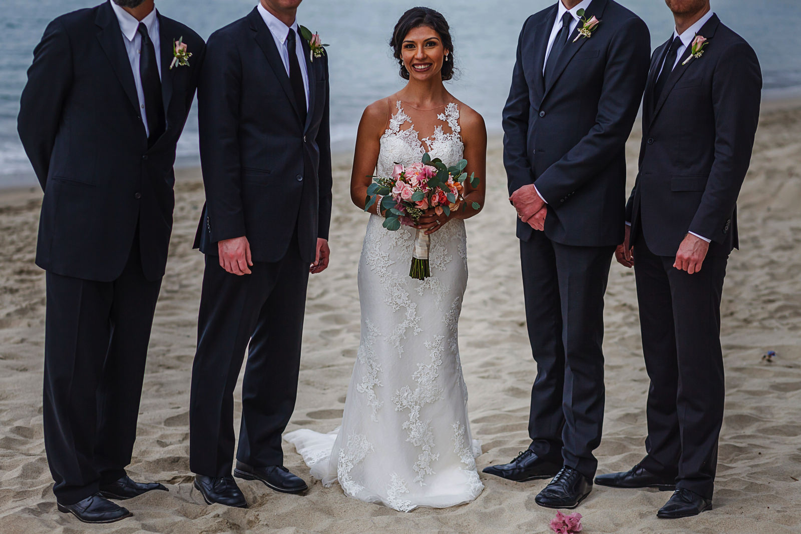 Portrait of bride with groomsmen on Bucerias beach