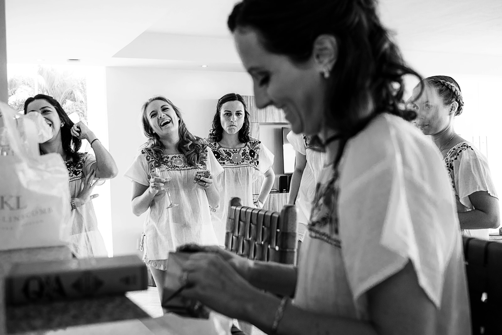Bridesmaids enjoying the present from groom to bride - Eder Acevedo cancun los cabos vallarta wedding photographer