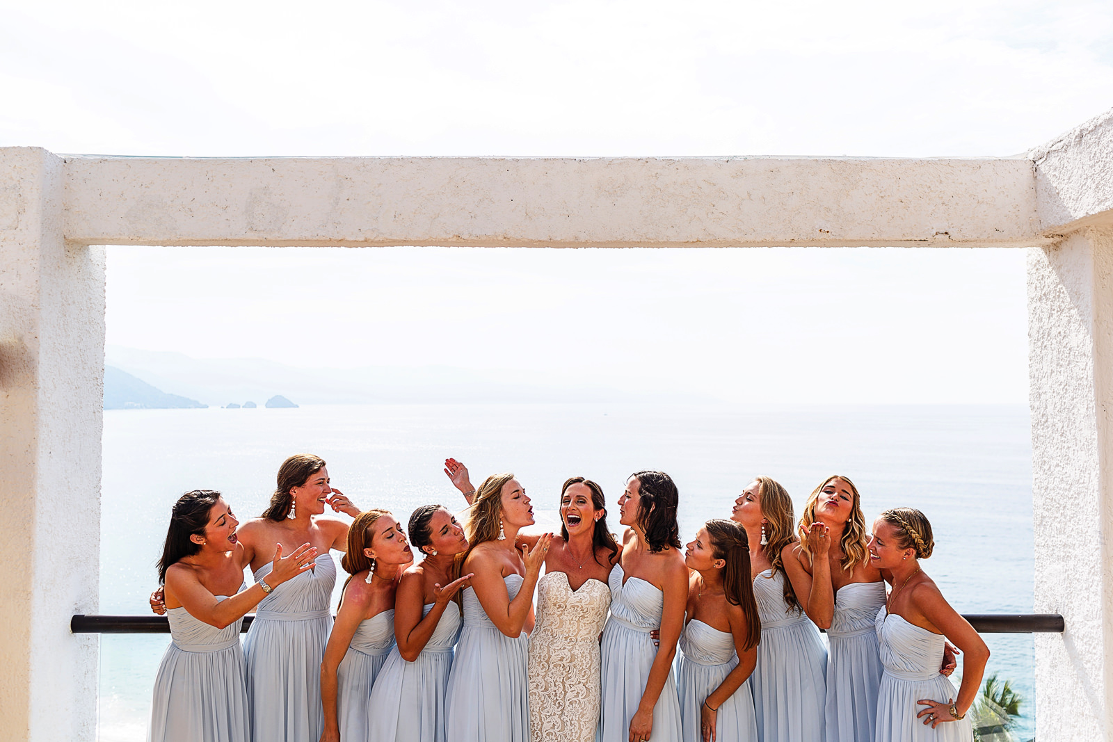Bride and bridesmaids portrait at the terrace of the suite in Hyatt Ziva resort - Eder Acevedo cancun los cabos vallarta wedding photographer
