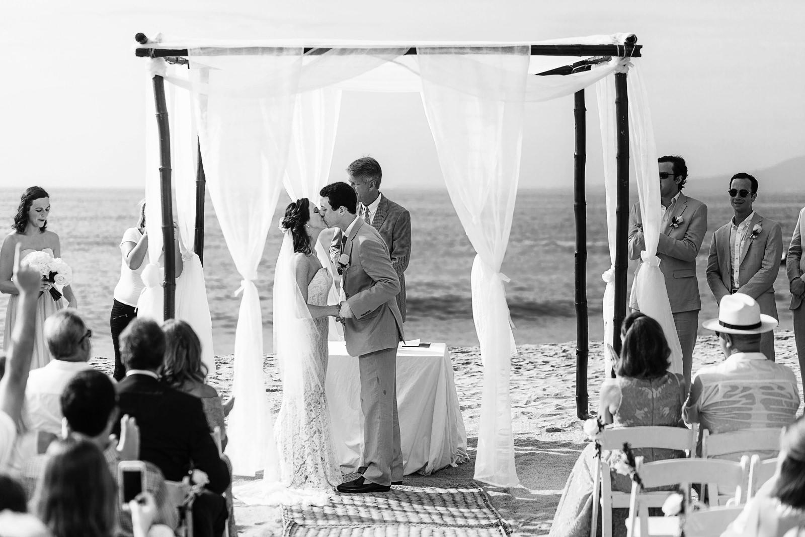 Kiss at wedding ceremony on the beach - Eder Acevedo cancun los cabos vallarta wedding photographer