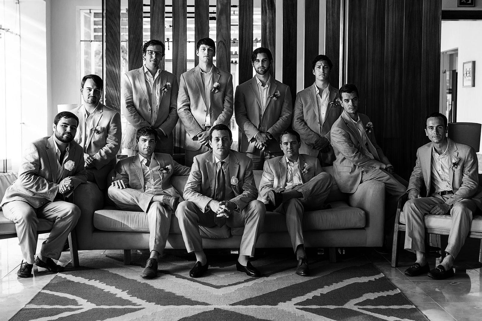 Groom with groomsmen portrait at sunset bar in Hyatt Ziva resort - Eder Acevedo cancun los cabos vallarta wedding photographer