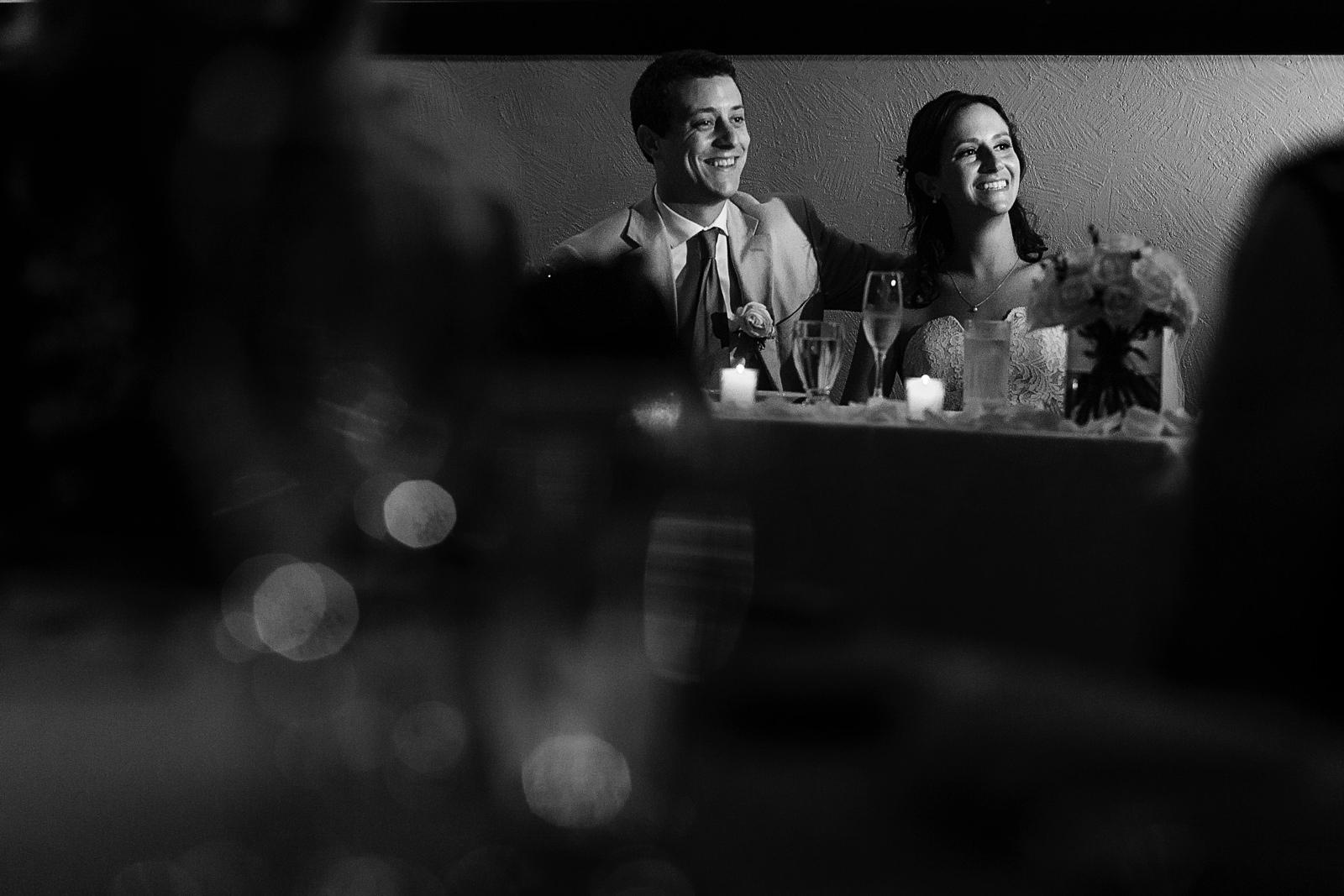 Couple's reaction to father of the bride speech during wedding reception - Eder Acevedo cancun los cabos vallarta wedding photographer