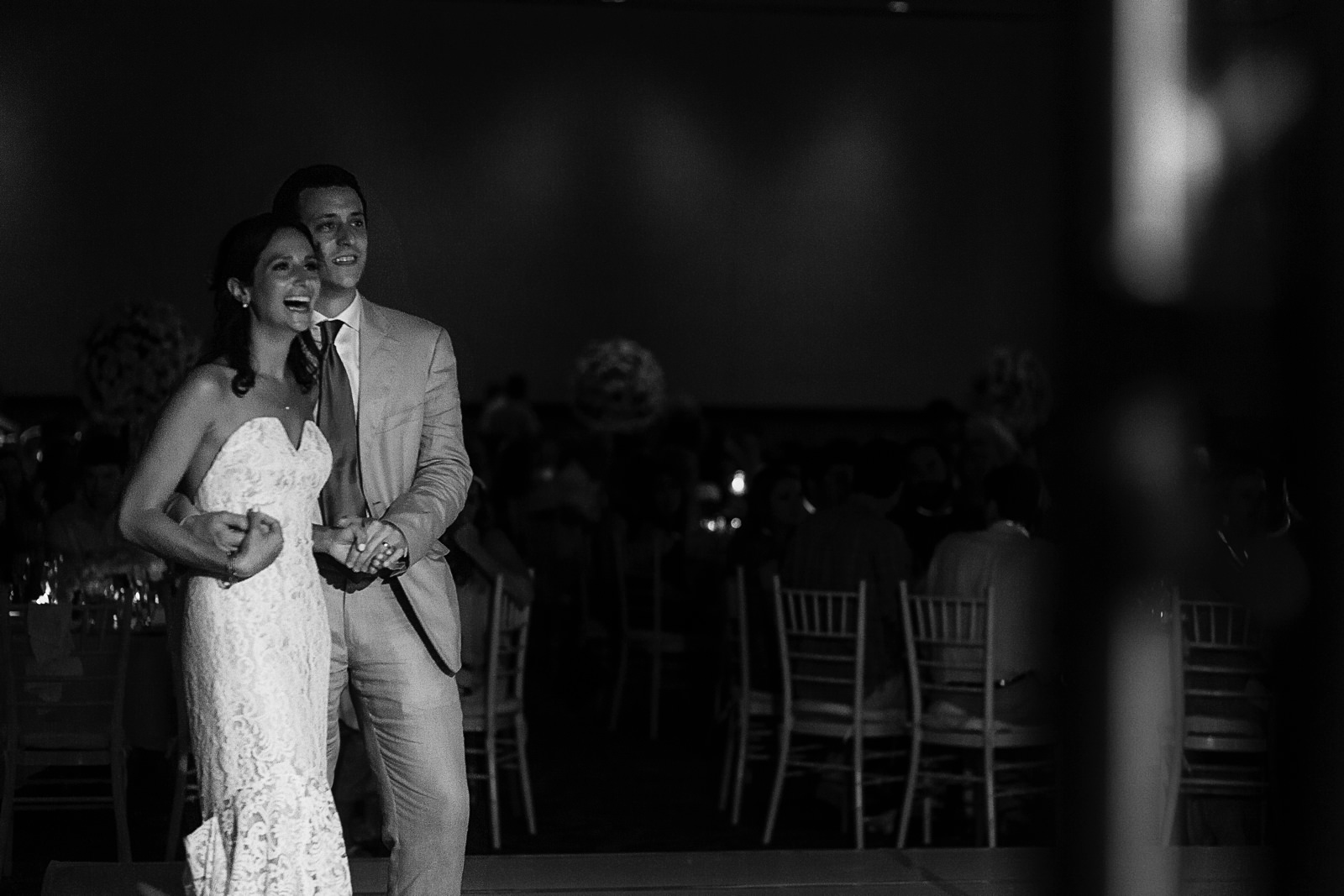 "Couple reaction to bridesmaid singing ""At last"" on stage during wedding reception - Eder Acevedo cancun los cabos vallarta wedding photographer"