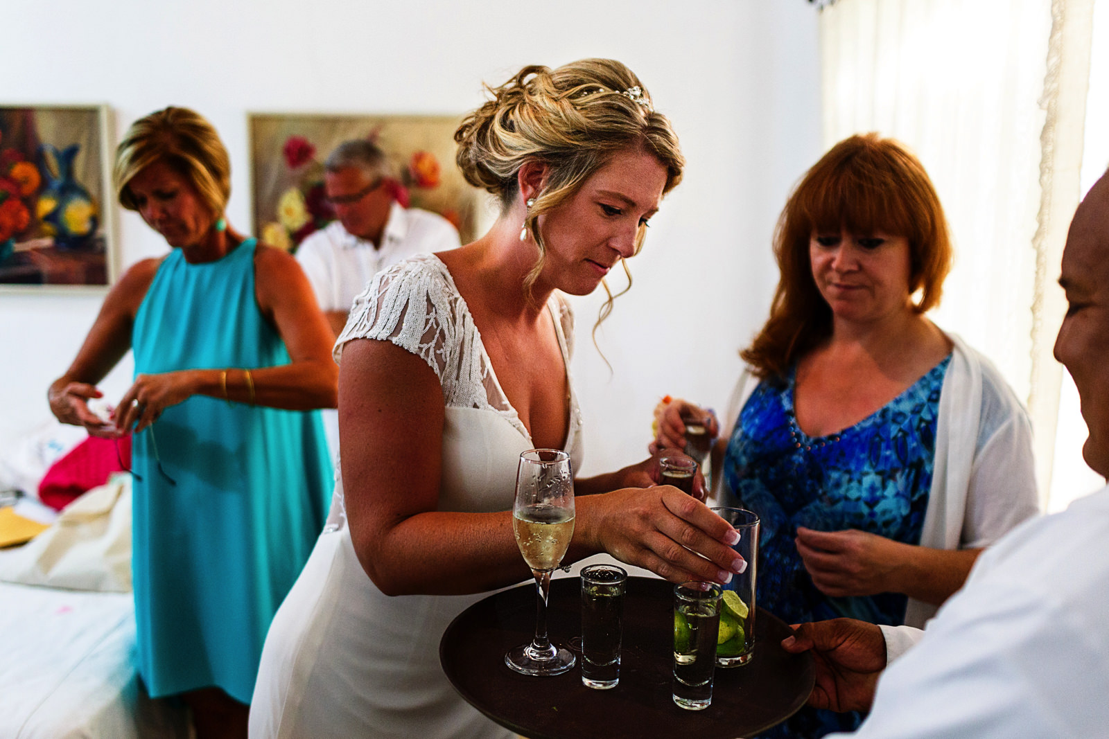 Bride and mother-in-law about to have a shot of tequila before the wedding ceremony