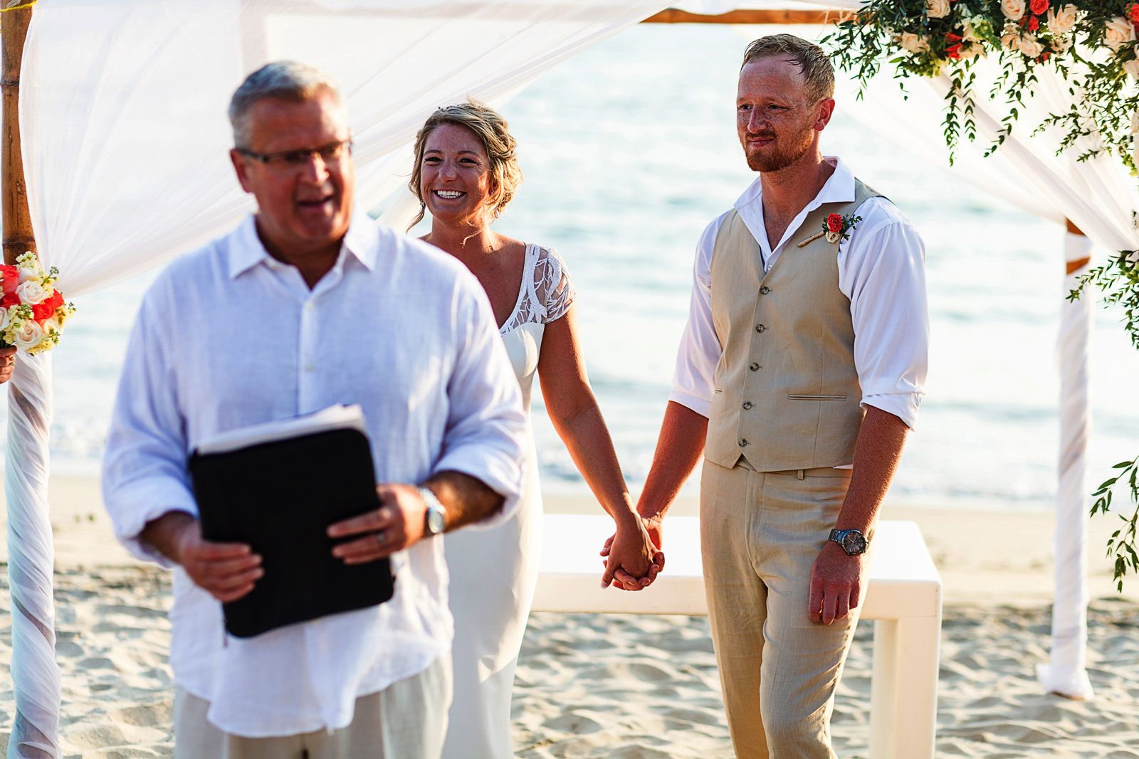 Bride and groom during wedding ceremony on Bucerias beach Nayarit Mexico