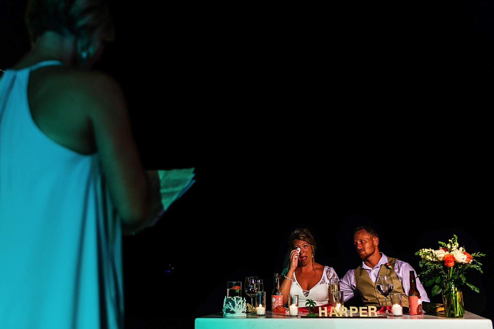 Bride crying during aunt's speech and toast at destination wedding reception