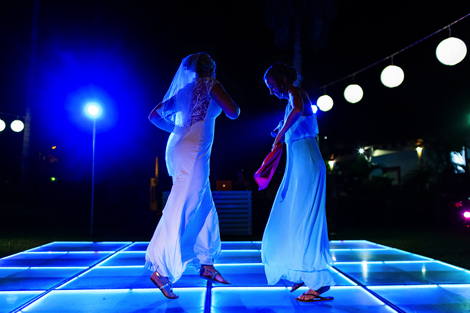Bride and maid of honor dancing in the dance floor as part of the speech during destination wedding reception