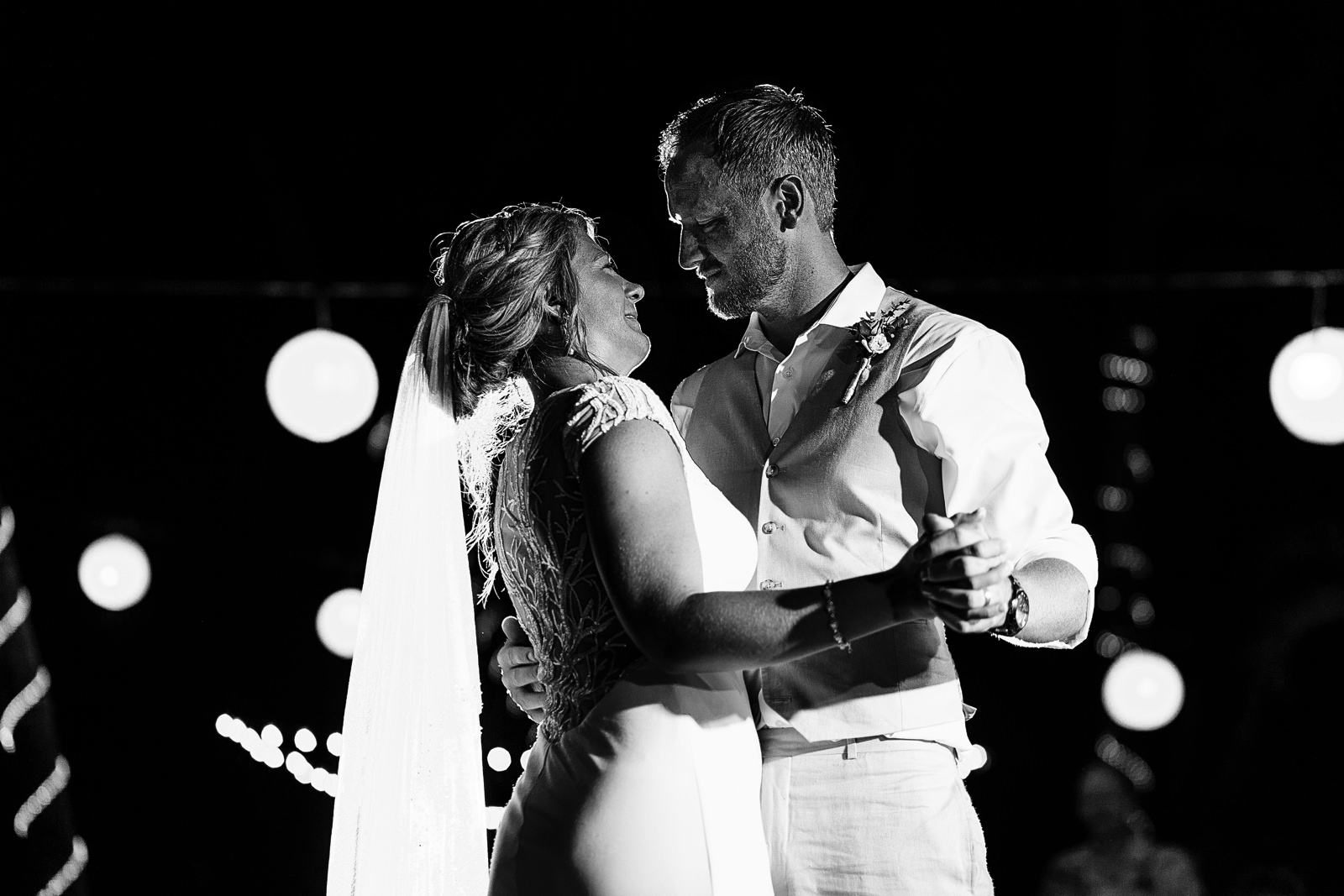 Bride and groom looking into each other eyes during their first dance