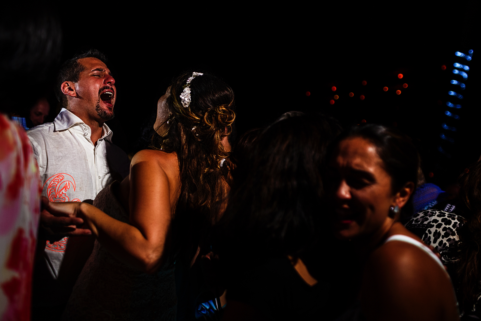 Groom singing while dancing with the bride in the crowd