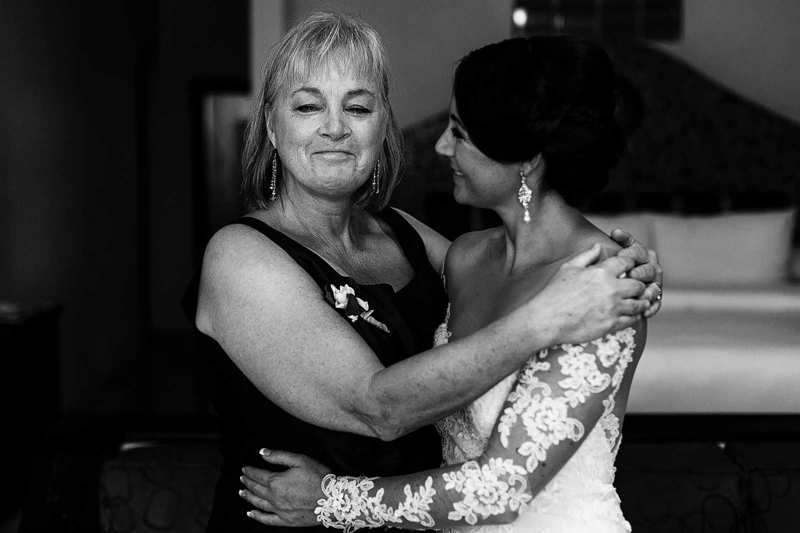 Aunt of the bride crying after a hug