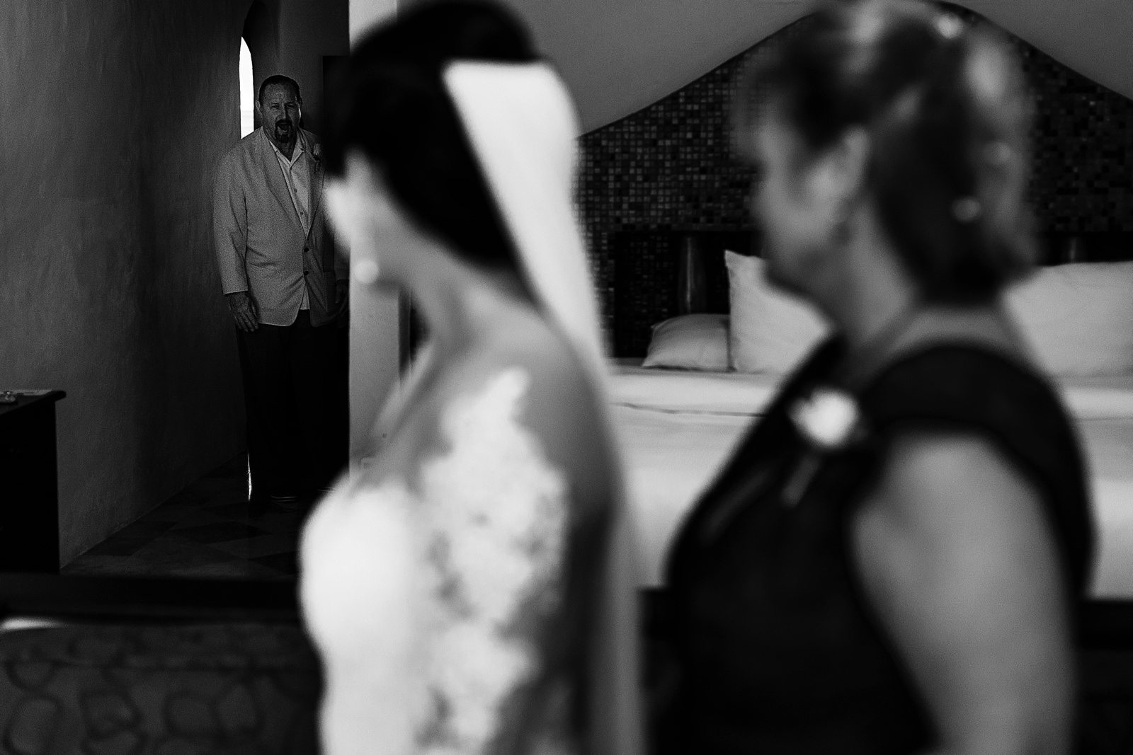 Father of the bride walking into the bridal suite before the ceremony