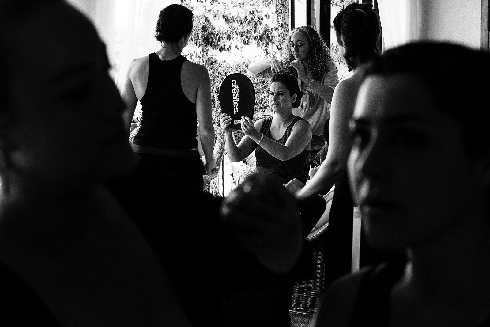 Bride looking her make-up and hair in a mirror