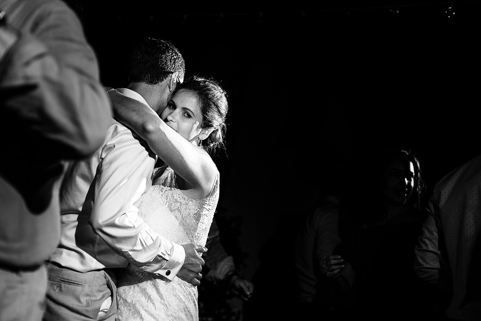 Destination wedding couple hugging and dancing during their reception party