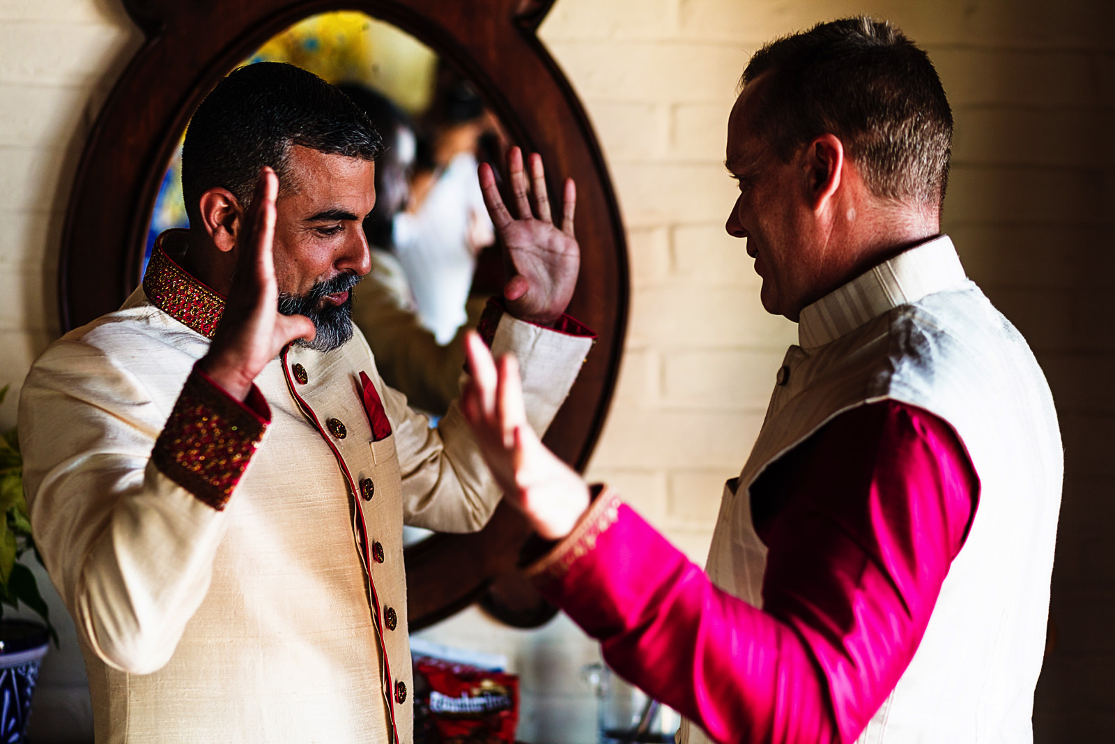 Hands explote as part of the groom and best man preparation ritual