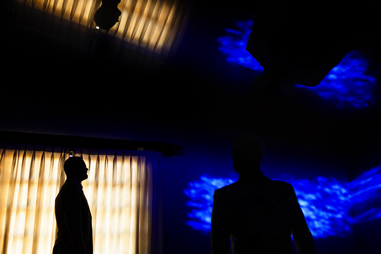 Abstract portrait of gay couple in yellow and blue with silhouettes