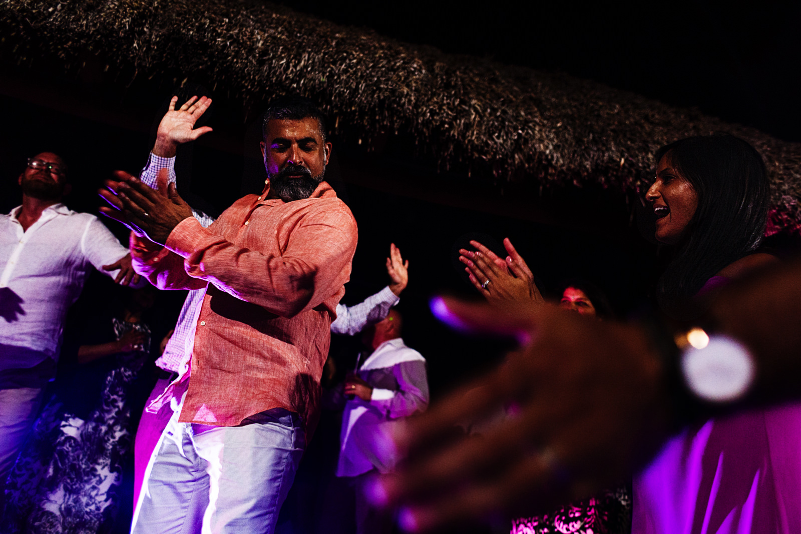Groom dances hindi music style around the wedding guests clapping