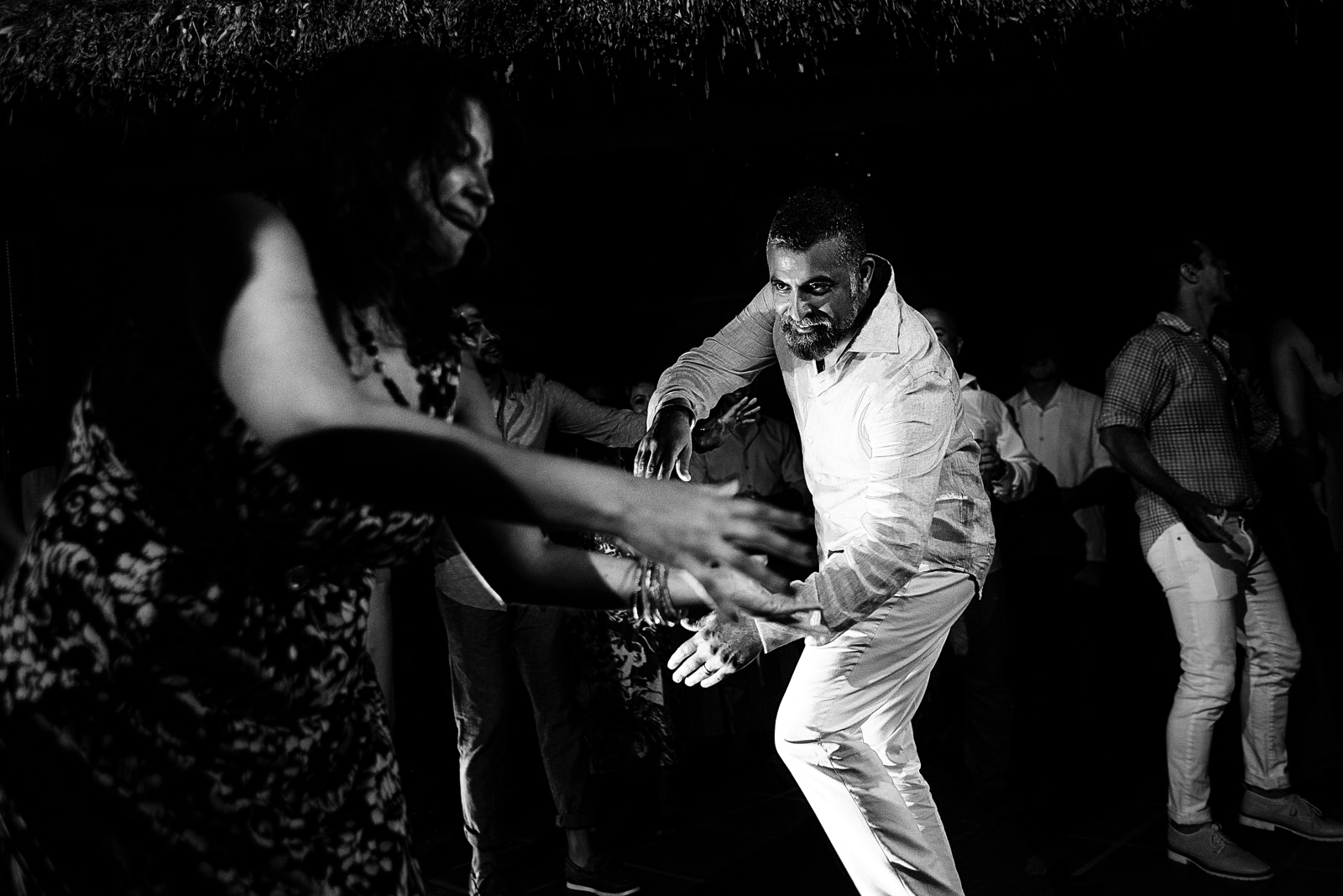 Groom and his sister dancing during the wedding reception