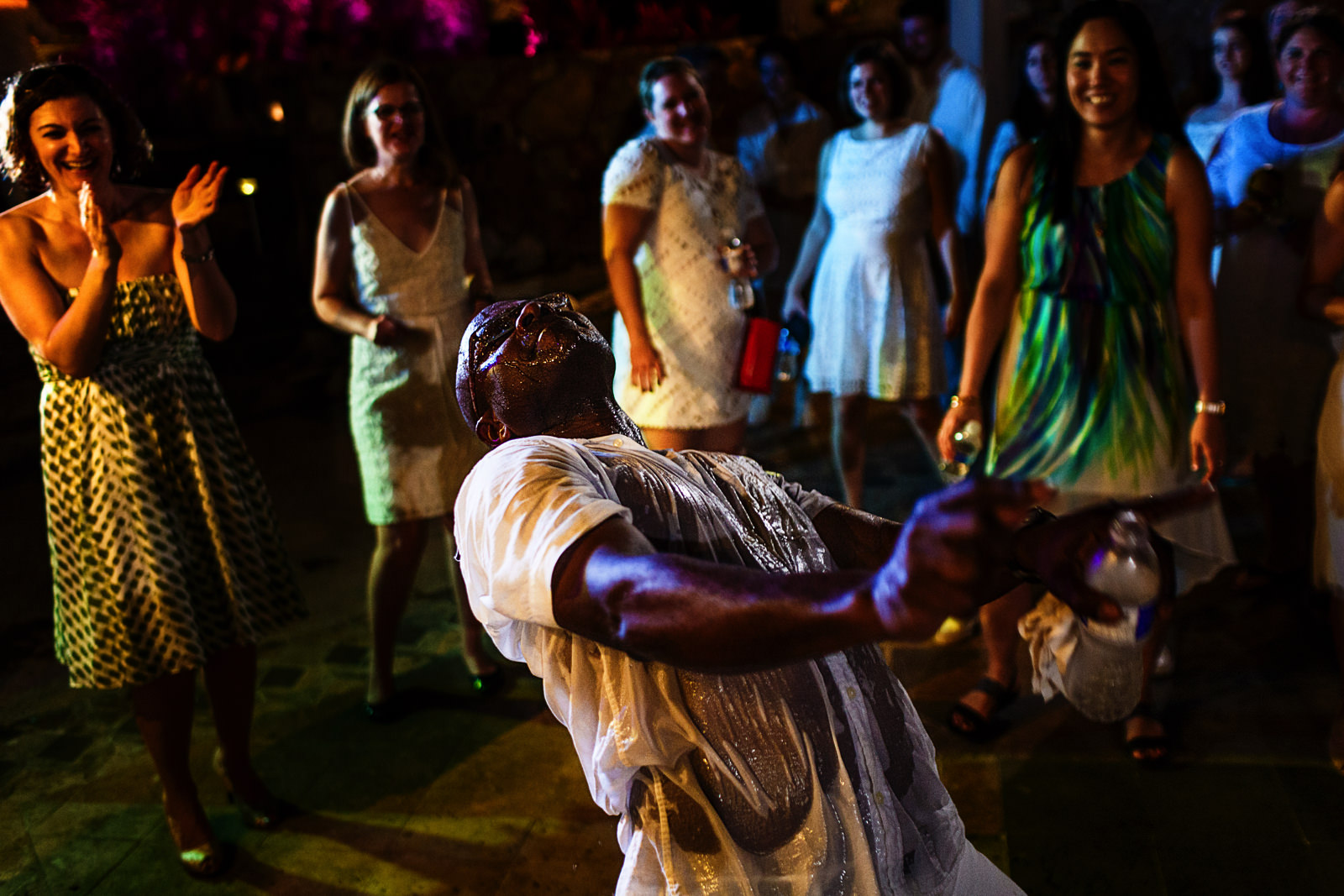 Wedding guest soaked wet dance intensively while other guest laugh and enjoy