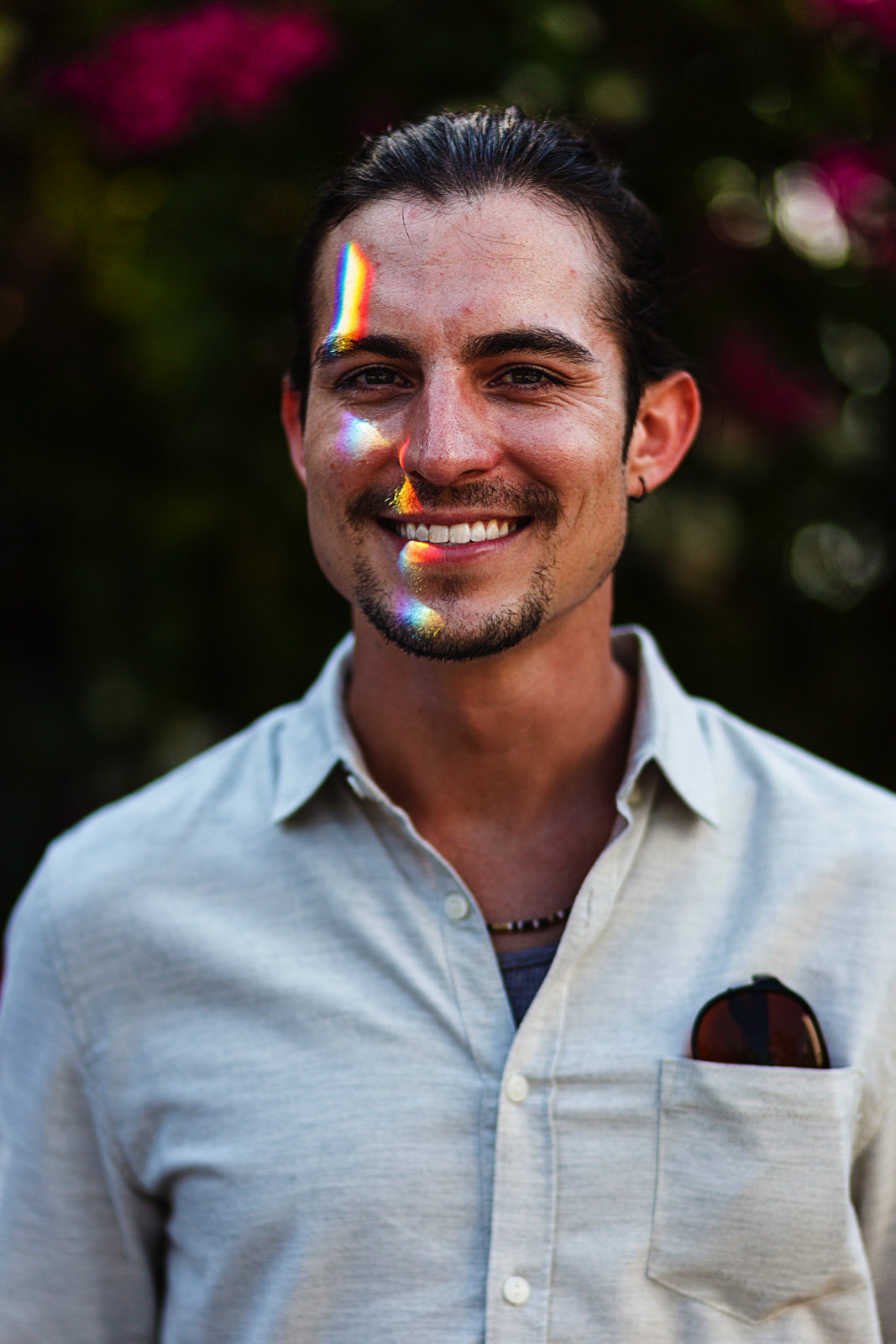 Groom portrait with a prism light on his face