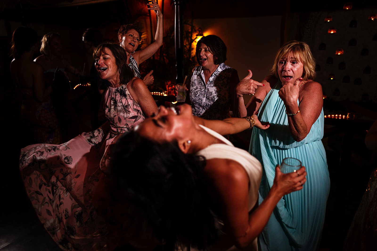 Female wedding guests all bringing their best moves at the dance floor