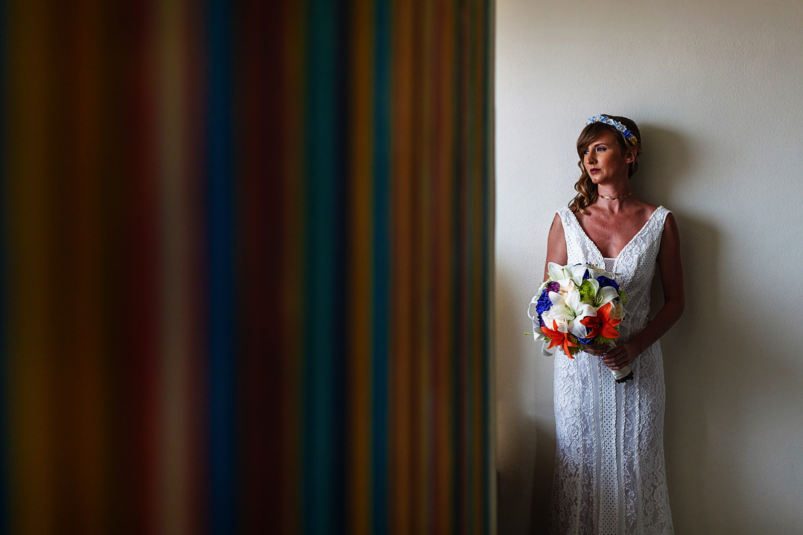 Colorful portrait of the bride light up by the window