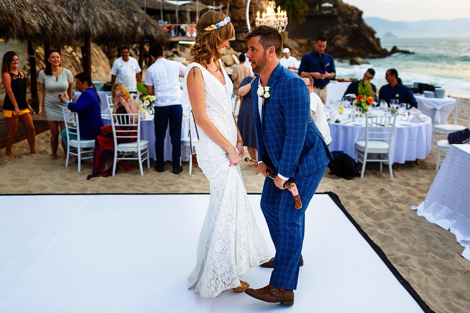 Bride and groom dance as part of their entrance into the reception on the beach