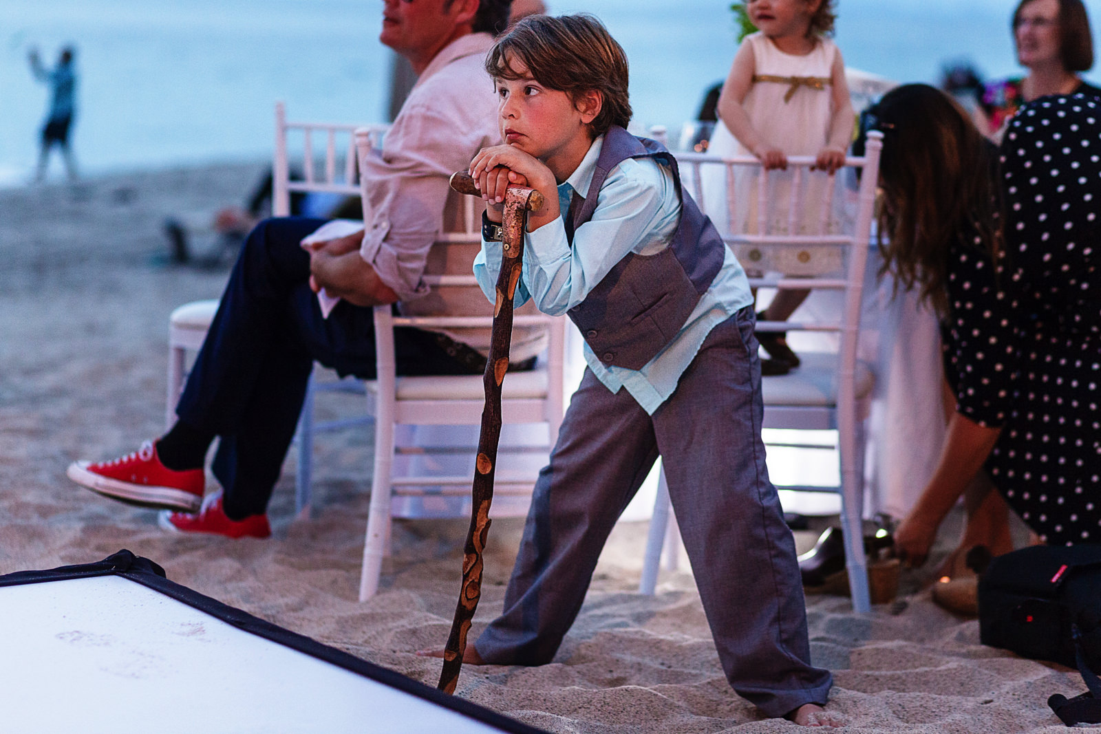 Kid leans on a cane during speeches