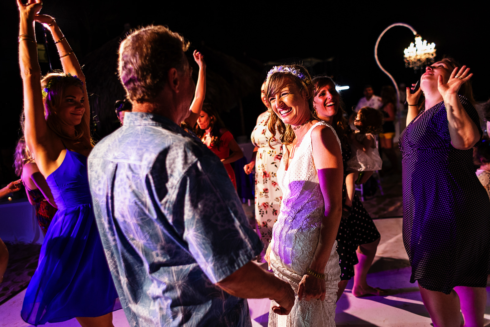 Bride dancing with the guests at the wedding reception