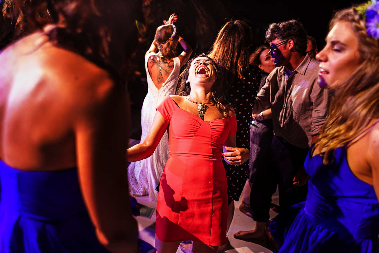 Wedding guest laughing while dancing