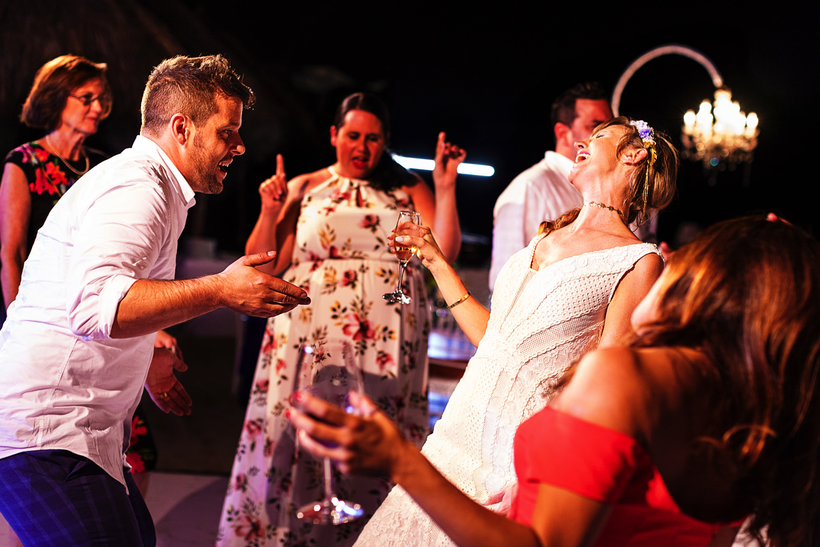 Groom and bride enjoying the dance floor singing and dancing