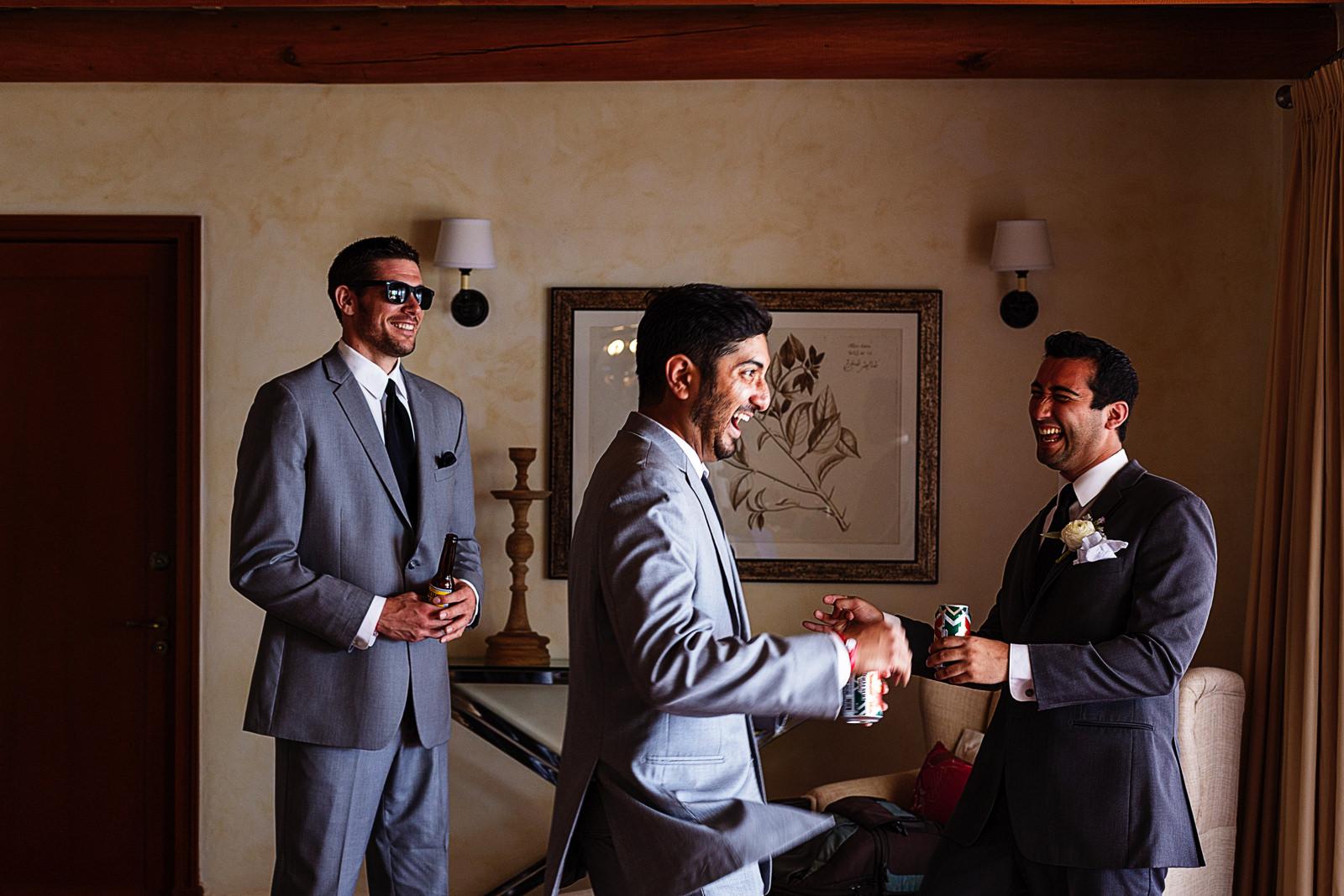 Groom and groomsmens having fun on the guy's room.