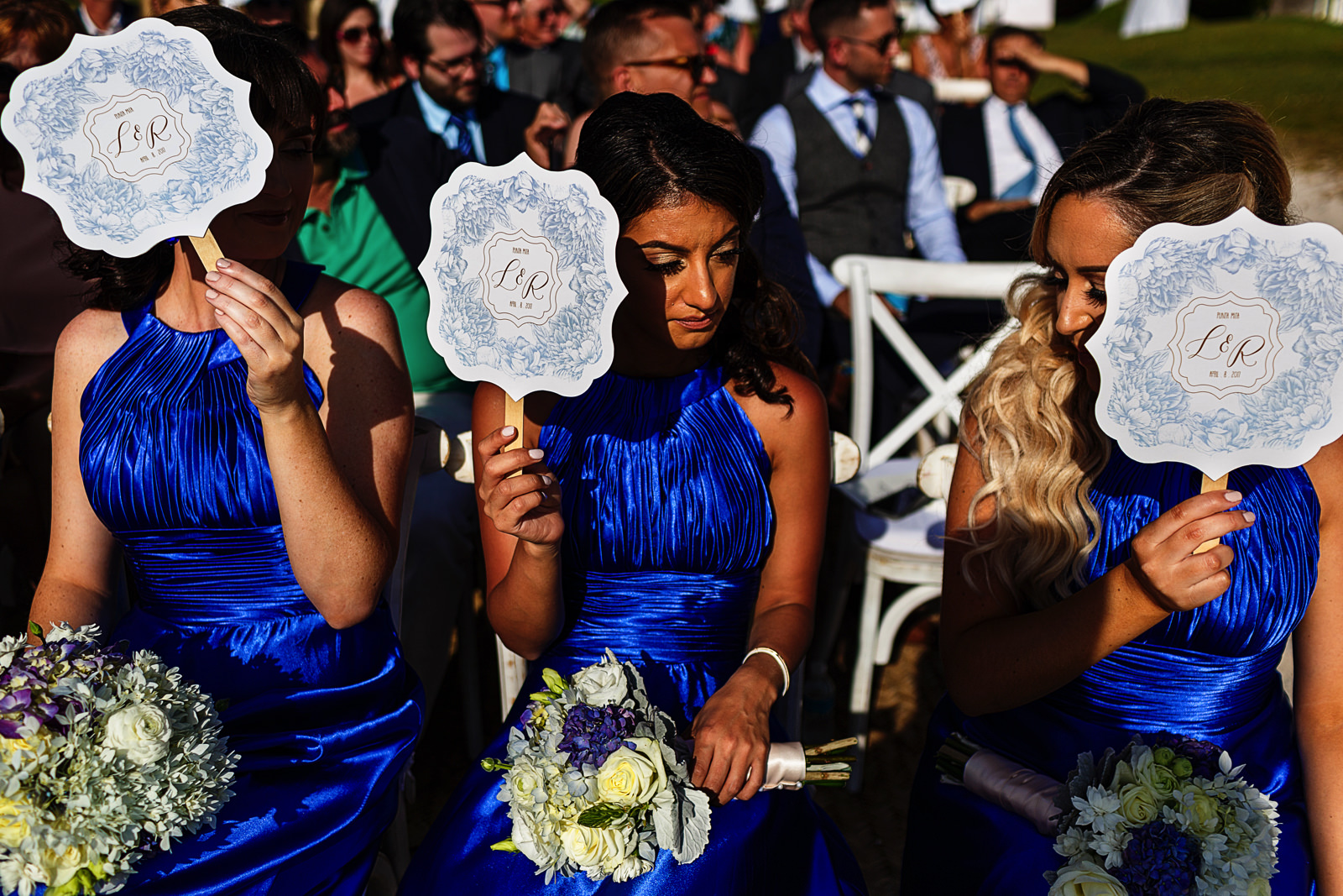 Light and heat from the sun hits hard on the bridesmaids during the wedding ceremony on the beach at the St. Regis Punta Mita Resort.