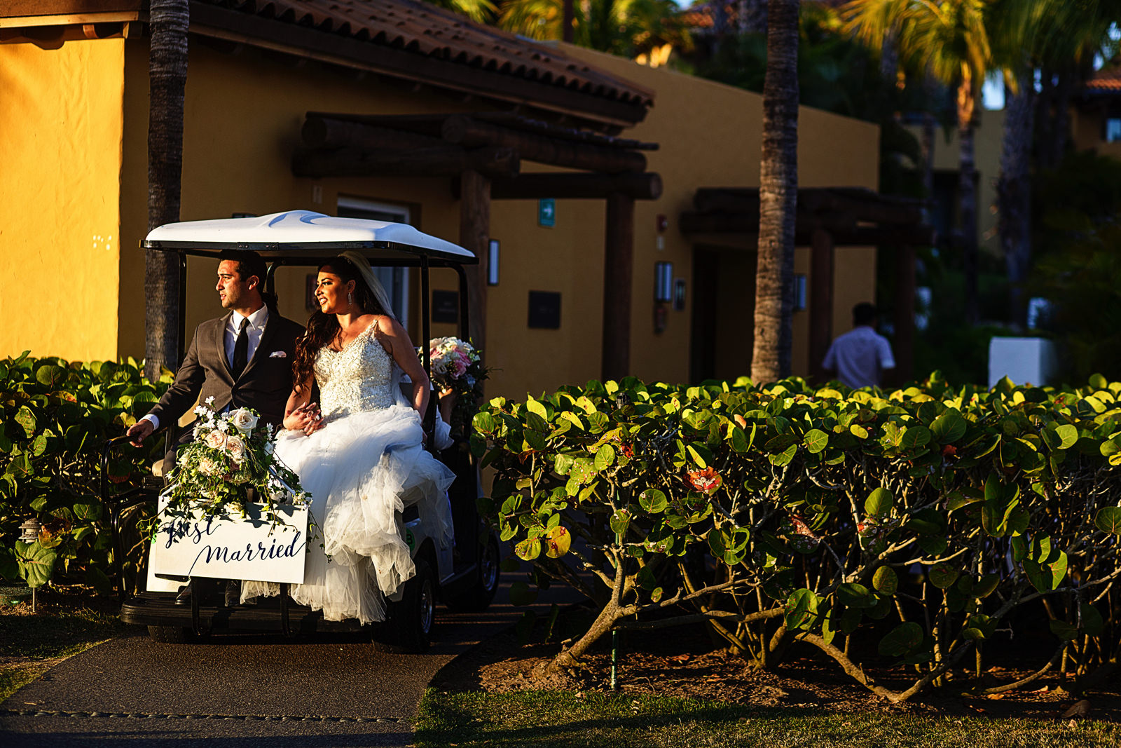 "Golf cart as the wedding couple's getaway with a ""Just Married"" sign attached in the back."
