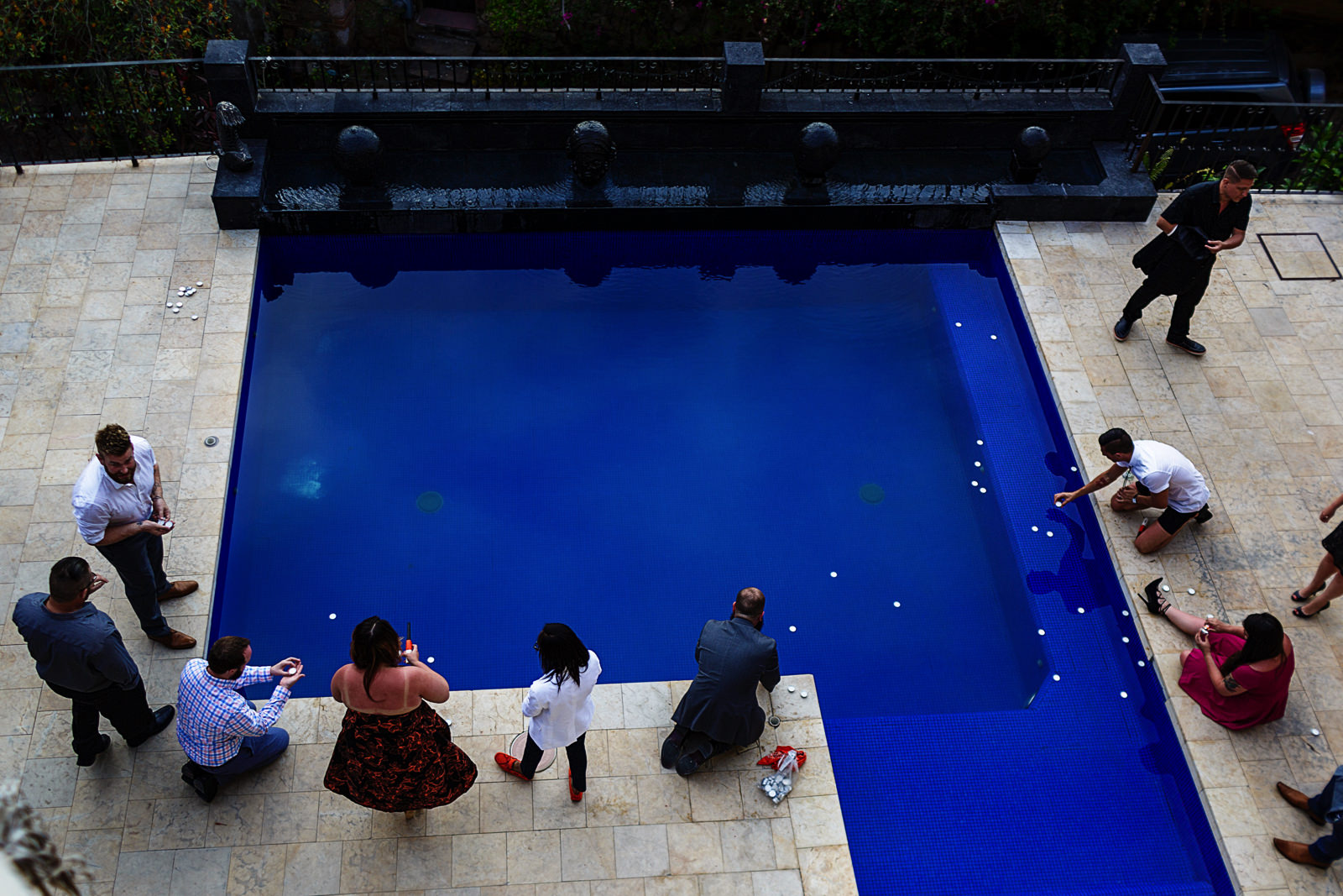 guests-lighting-candles-pool