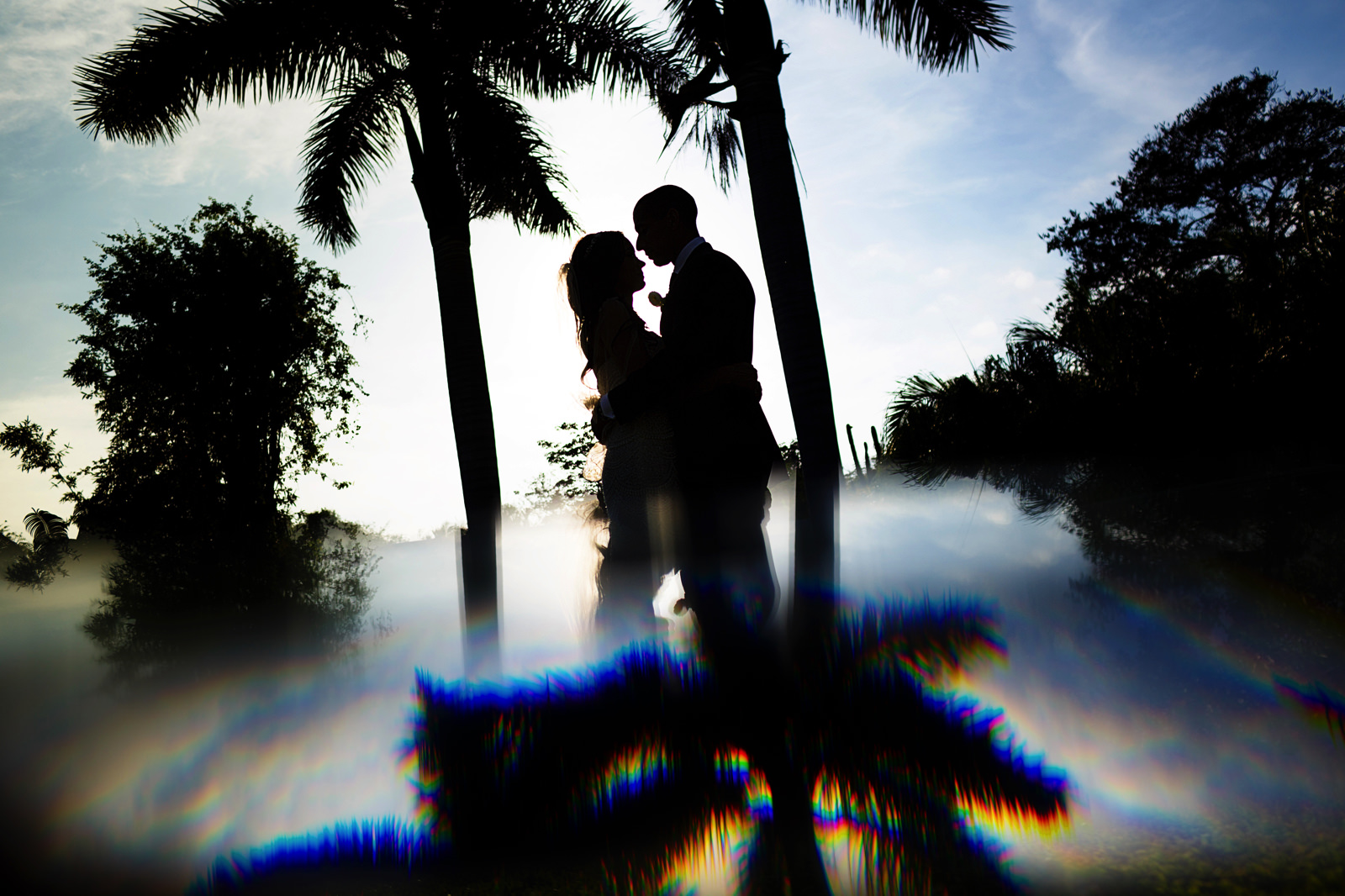 Silhouetted portrait of the wedding couple at the garden of Casa China Blanca in Punta de Mita, Mexico.