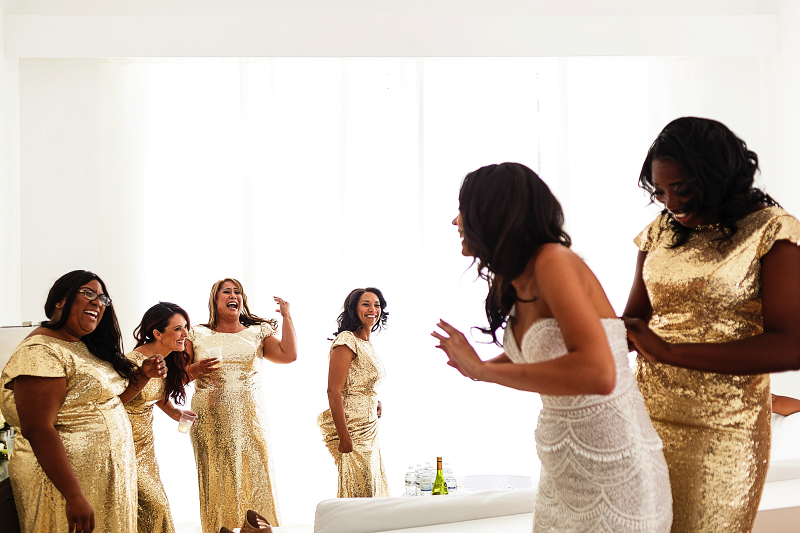 bridesmaid-helping-bride-dress
