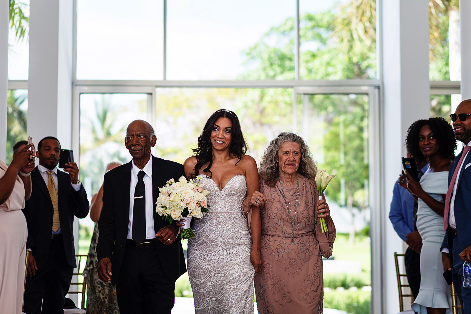 bride-walking-down-aisle-with-parents
