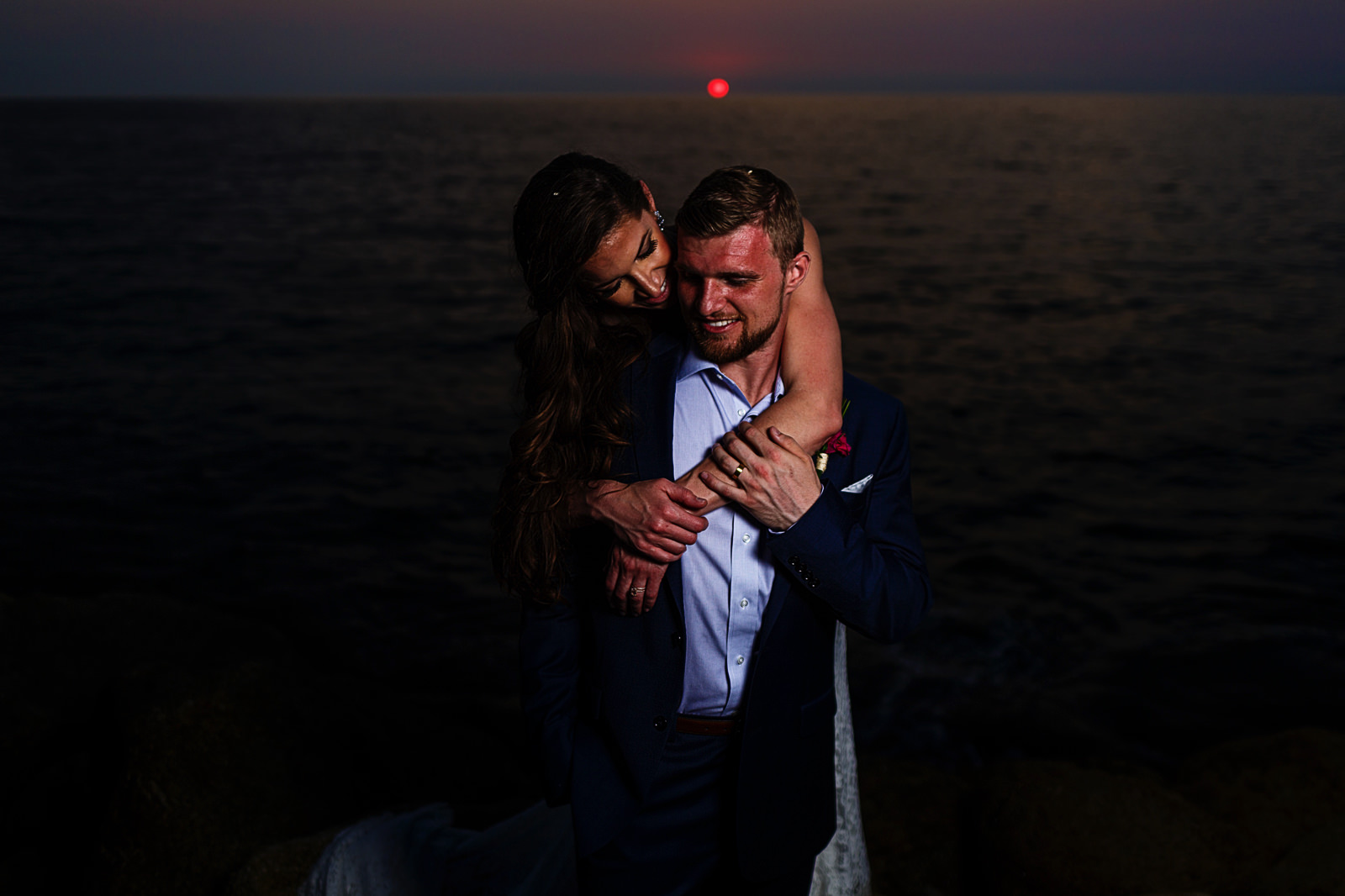 Wedding couple against the pacific ocean in the sunset of Puerto Vallarta
