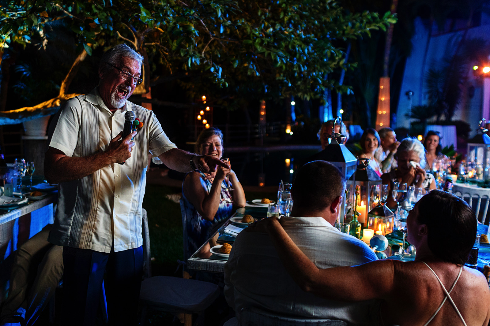 Father of the groom gives a speech during dinner