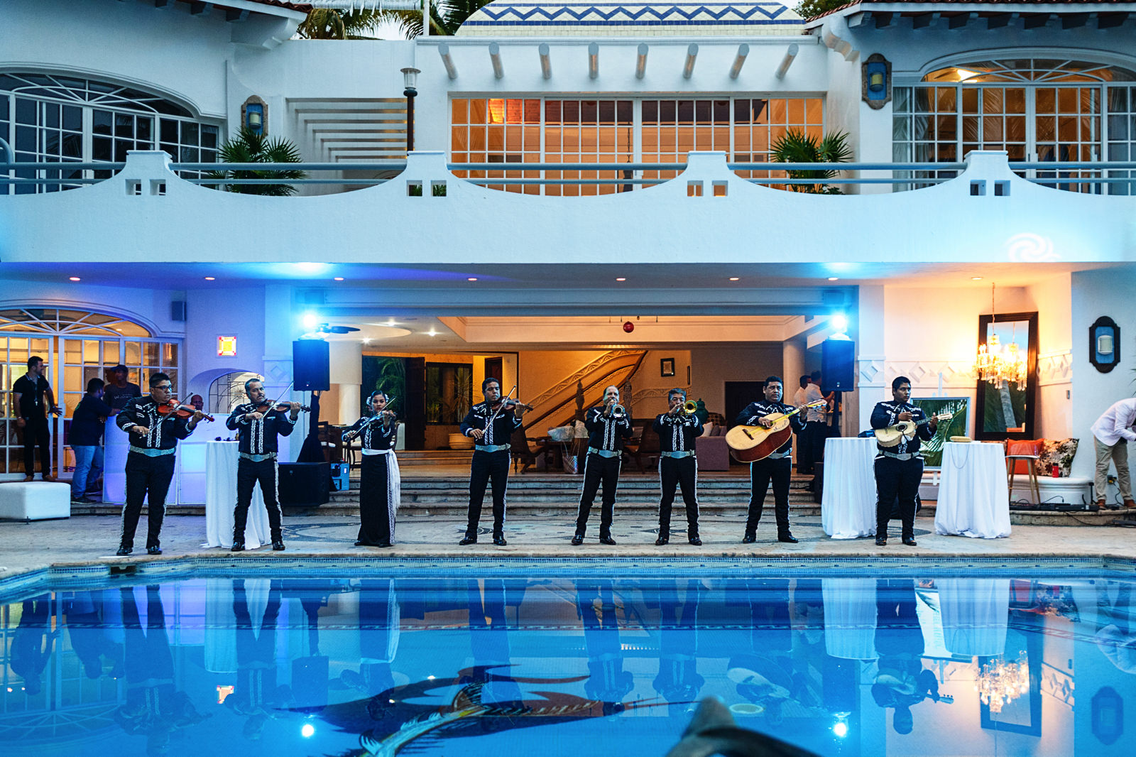 Mariachi band plays for all the wedding guests in the pool area at La Mansion Vallarta