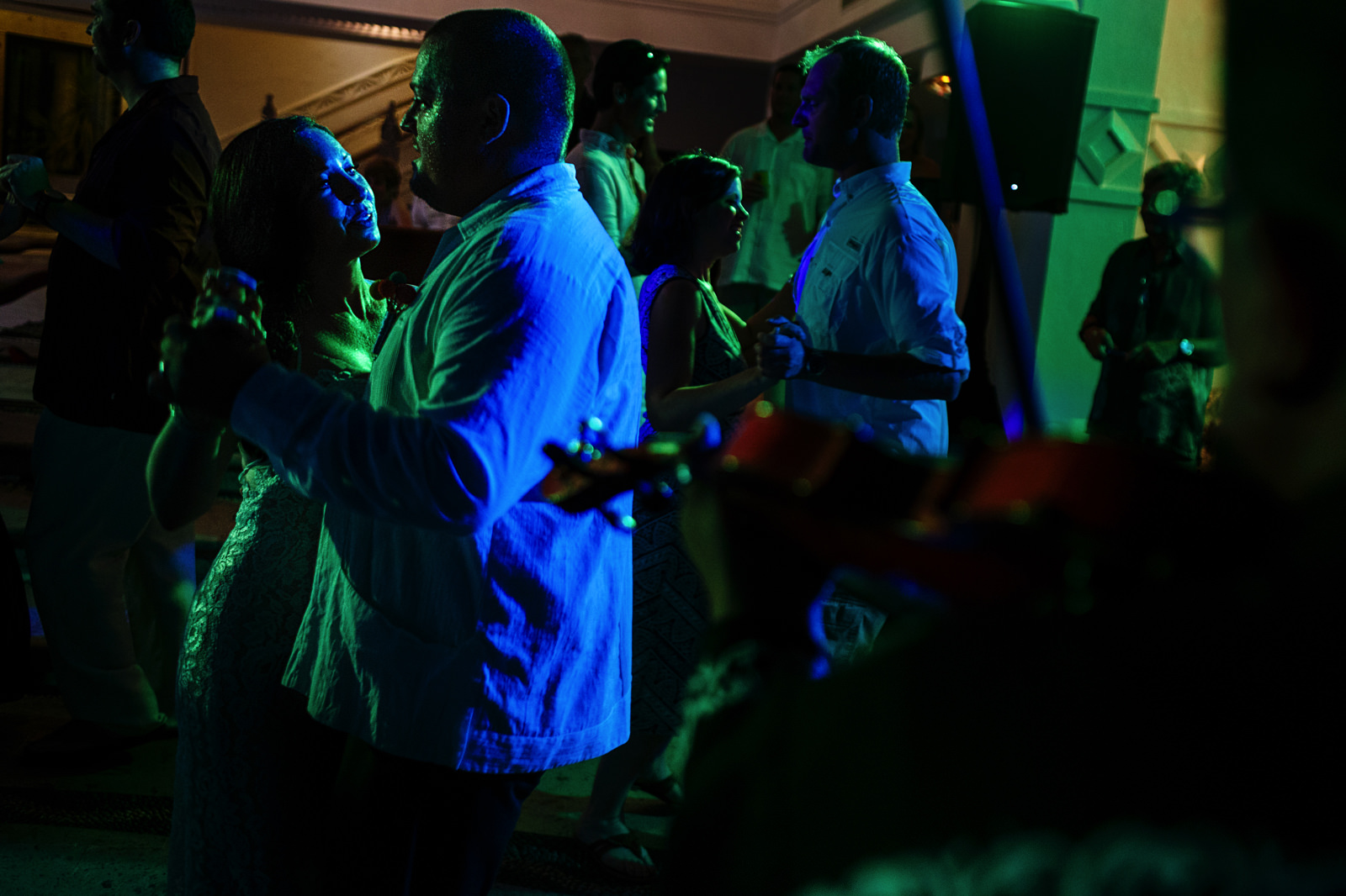 Groom and bride dancing between all their guests to the live mariachi music