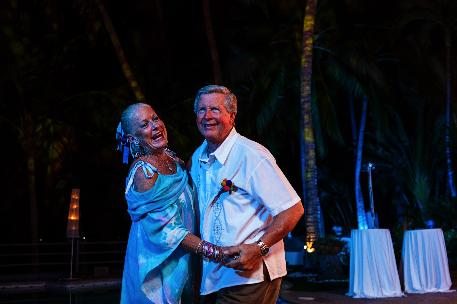 Parents of the bride dancing by themselves next to the pool at La Mansion Vallarta