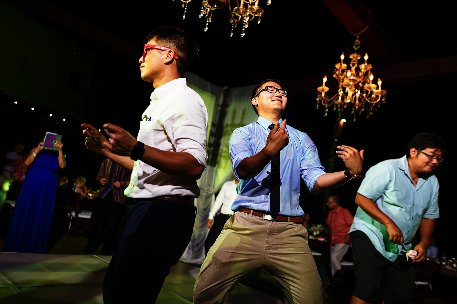 Wedding guests singing, dancing and enjoying the destination wedding reception.