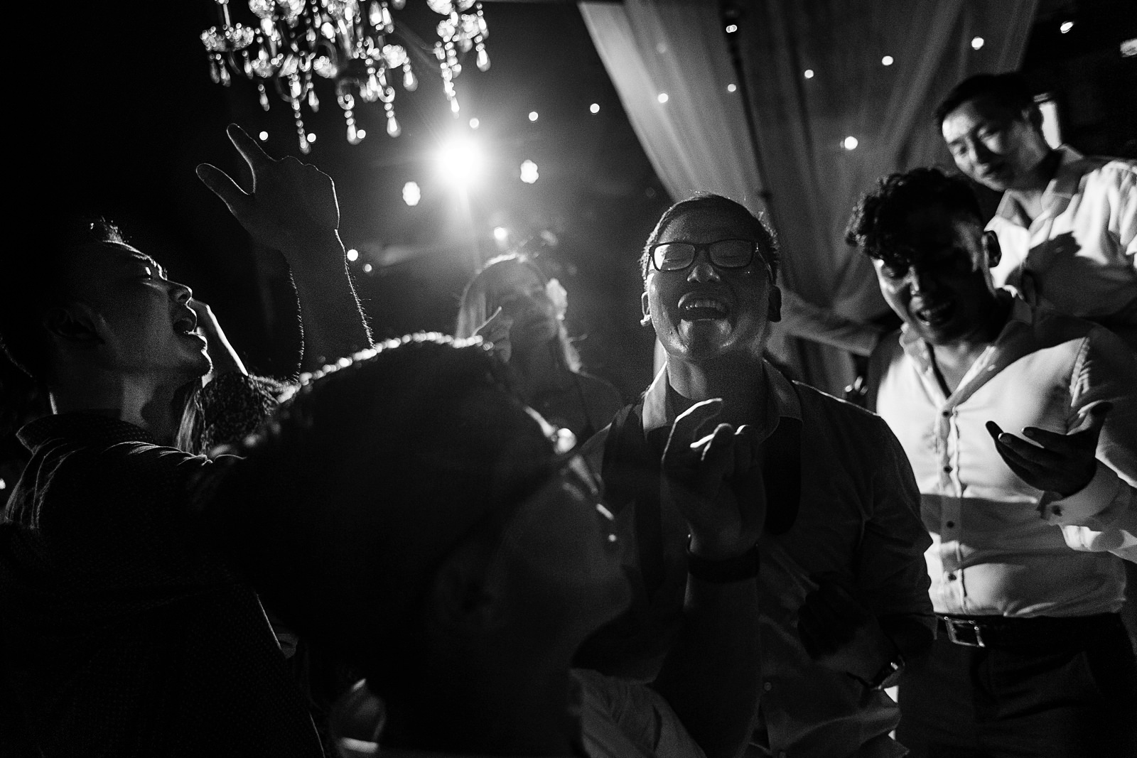 Wedding guests having the time of their lives on the dance floor at a wedding in Martoca Beach Garden.