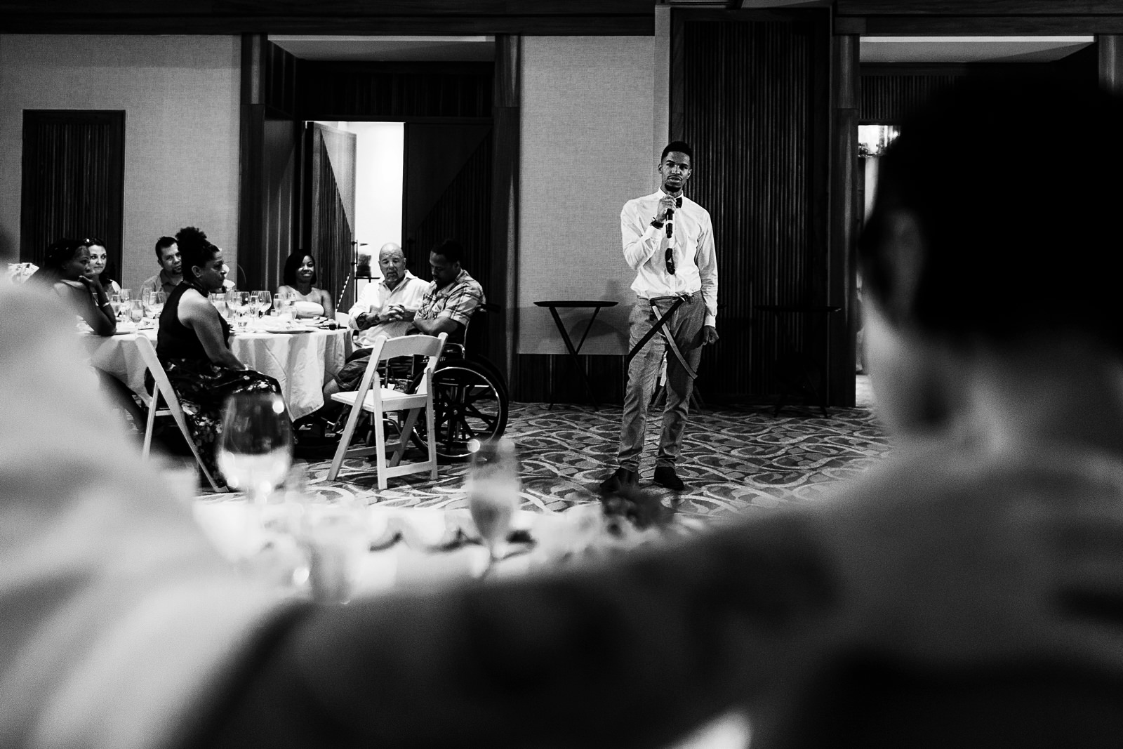 Young man giving a speech to the wedding couple in the ballroom of Hyatt Ziva resort