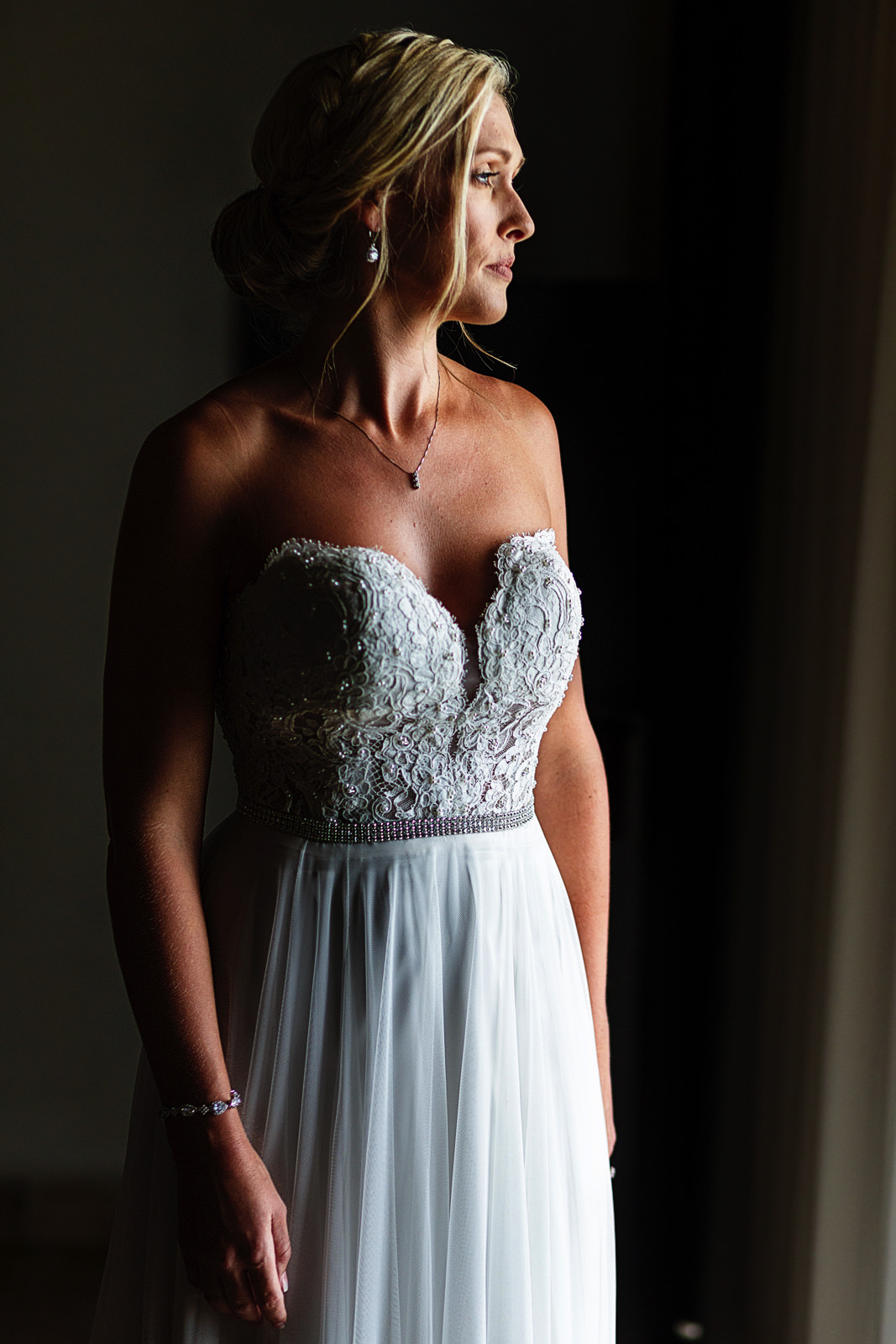 Bride's portrait standing close to a window