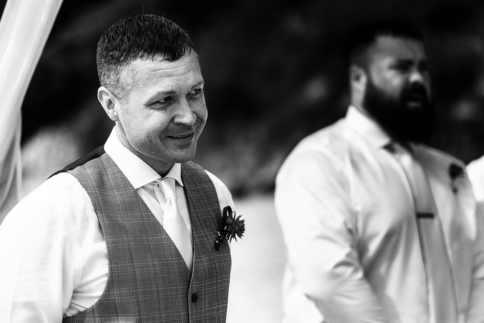 Groom crying over the entrance of his bride into the beach wedding ceremony