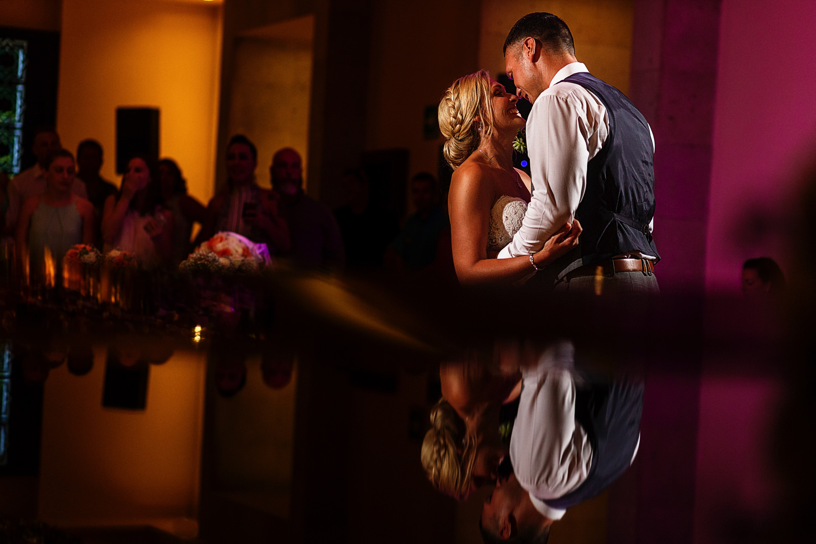 Groom and bride smiling during their first dance