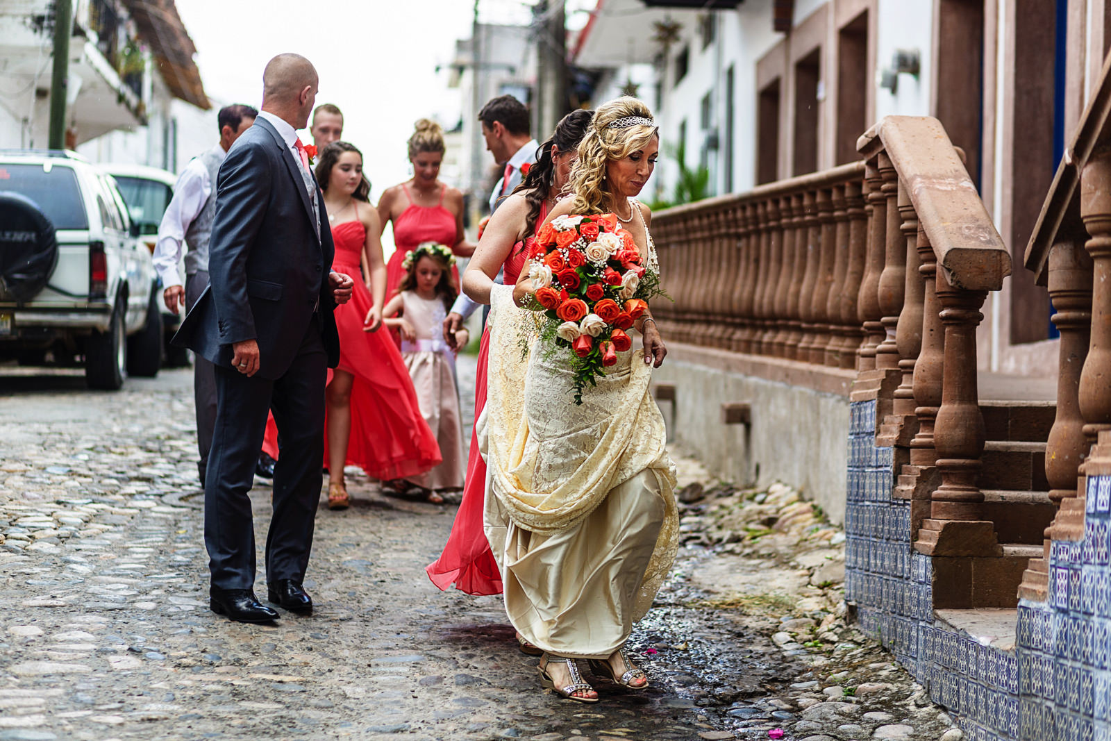 Bridal party walks in the streets of mexico after the ceremony to grab a cocktail