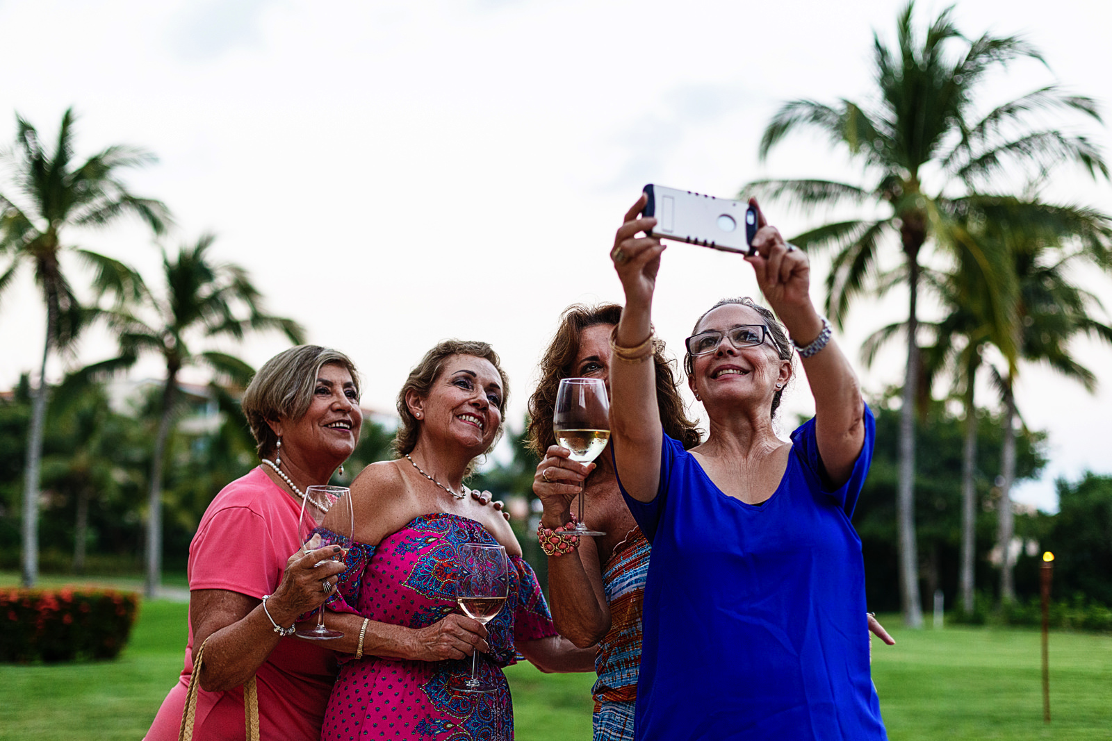 Mother of the groom and family girls taking a selfie with a cell phone
